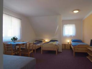 Penzion a chatky U Přehrady - pokoj č.1 pro 4 osoby