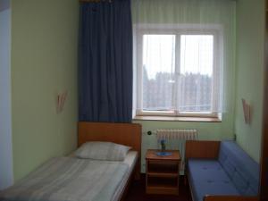 KOKY Šimanov - Pokoj v penzionu.