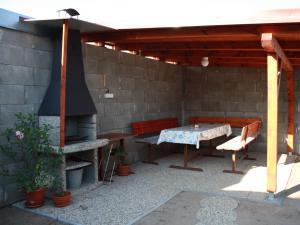 Ubytování U Janečků - Venkovní posezení, houpačka, skluzavka, pískoviště