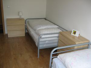 Apartmán Pod Dedovkou - Miestnosť s troma lôžkami