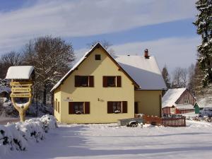 Dům s apartmány U Kožešníků - Zimní foto U Kožešníků