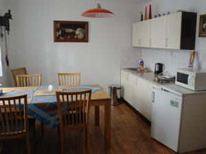 Apartmán Kvita - Jídelna s kuchyňskou linkou