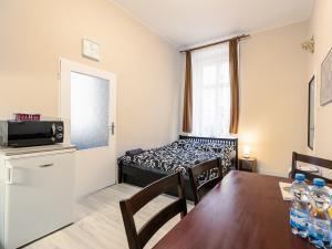 Apartmán Letná **** - ložnice / kuchyň