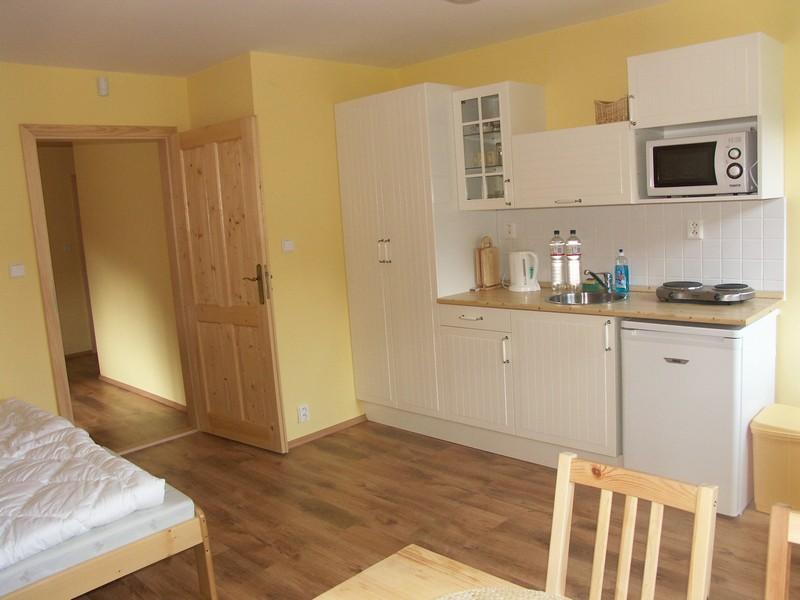 ložnice s kuchyňským koutem - apartmán č. 5